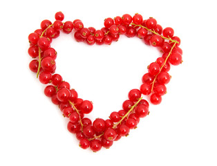 red berries in the shape of hearts over white background