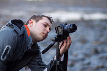 Photographer outdoors using tripod