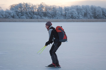 Skating on frosty lake