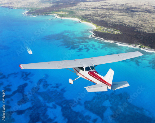 Wall mural small plane cruising