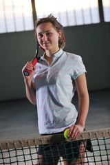 one young woman play tennis