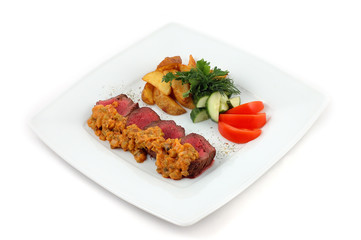 Meat with blood and vegetables