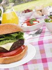 Al Fresco Dining With Hamburgers And Salad