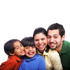 Faces of Family of Four Together in Colorful Shirts