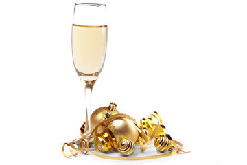 Gold Christmas balls with glass of fizz.
