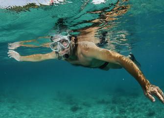man snorkeler underwater