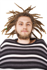 young dreadlock man lie isolated