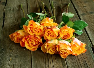 Bouquet of roses on old wooden boards