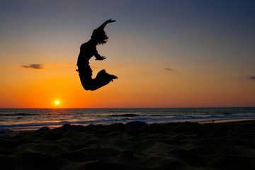 sunset jumping girl