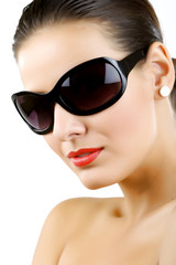 Woman in sunglasses glamour portrait.