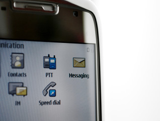 Personal digital assistant screen showing PTT and Mesaaging icon