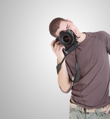 happy young casual man with camera
