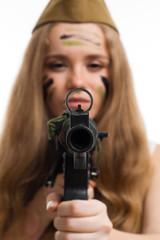 Woman look at camera through gun sight