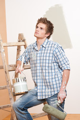 Home improvement: Young man with paint roller