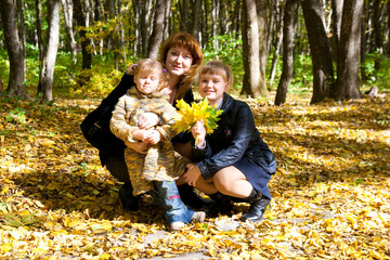 family in autumn leafs