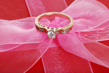 diamond ring on pink bow