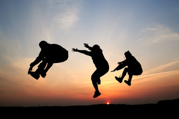 Silhouette of three men jumping 08