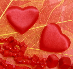 Hearts and beads on leaves