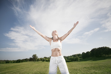 woman with open arms laughing