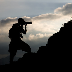 Silhouette of the photographer on a hillside