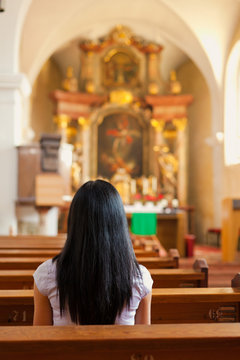 Women pray in a church