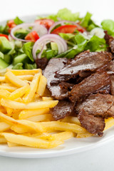 Grilled meat with fried potatoes and vegetables