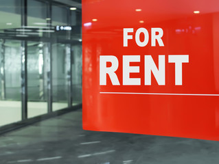 For Rent. Empty shop with a red 'For RENT' poster.