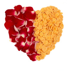 Half-and-half cornflakes and red rose petals heart