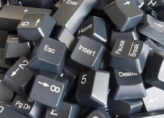 Stack of black computer keyboard keys