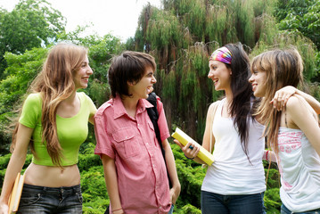 happy young students in park