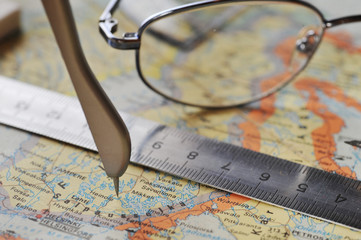 map and  glasses