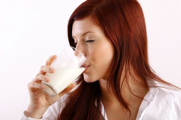 beautiful woman with a glass of milk