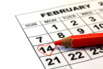 Valentine's Day calendar date with wooden pen
