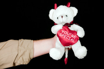concept valentines teddy in white on black background