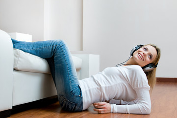 Young smiling woman listening music