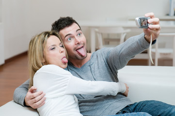 Young couple making faces and photo