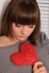 young girl holding the heart in her hands