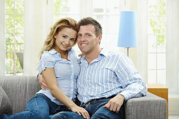 Happy couple on sofa