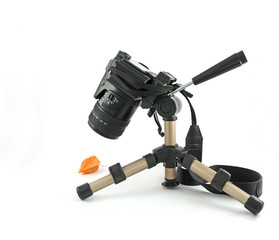 Modern digital camera on a mini tripod