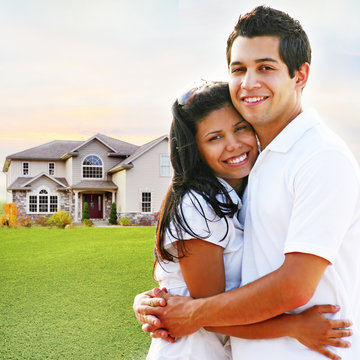 Happy Couple Embracing in Front of House