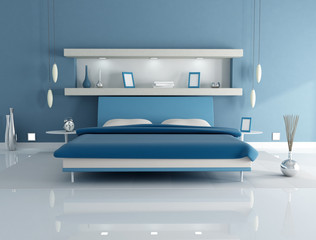 double bed in a blue bedroom with niche