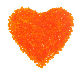 Red caviar in the form of heart on the white background