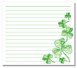 Hand drawn shamrock on white note paper