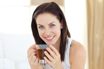 Brunette woman drinking tea