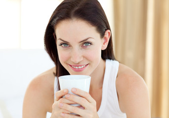 Close-up of a woman drinking a coffee