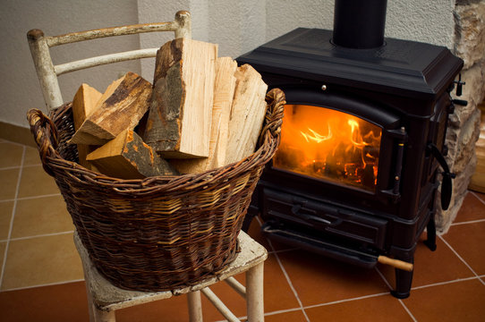 Logs in front of a stove