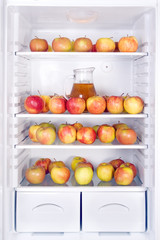 apples with jug in the refrigerator