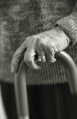 Senior womans hands on cane
