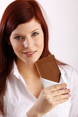 beautiful woman with a block of chocolate