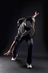 cool man modern dancer against black